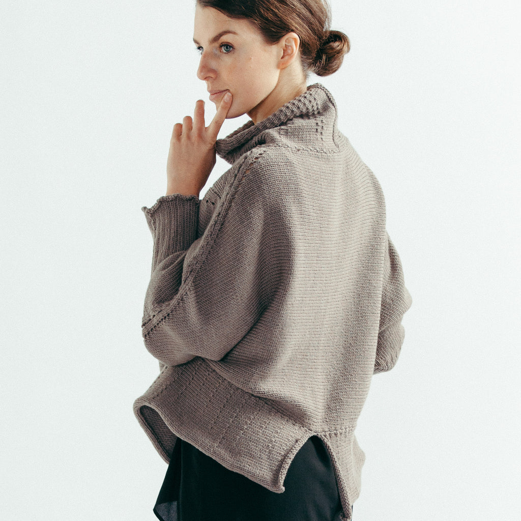 Back view of the Chunky Funnel Knit Batwing jumper in taupe merino wool