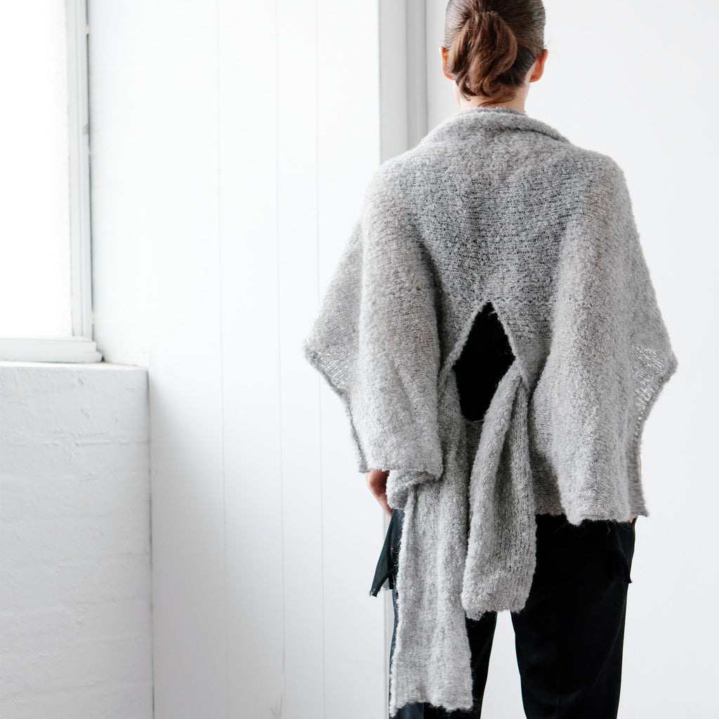 Back silhouette view of Cloud Wrap by Wendy Voon knits in Peruvian alpaca, worn cardigan style