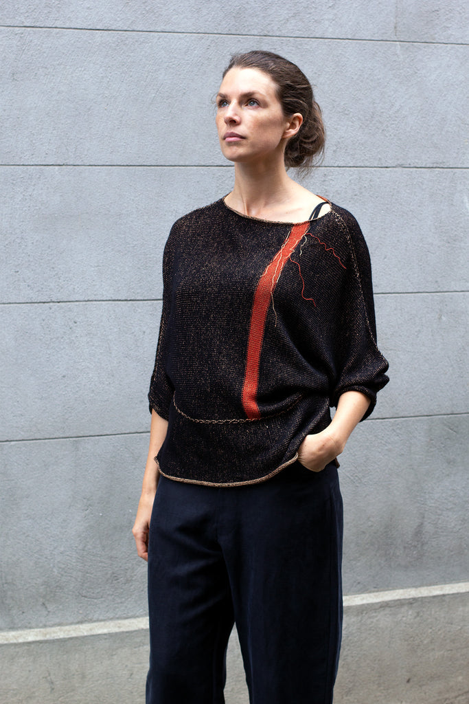 Front view of Single Stripe Dolman Jumper design by Wendy Voon in black merino with peach viscose reverse and rust stripe