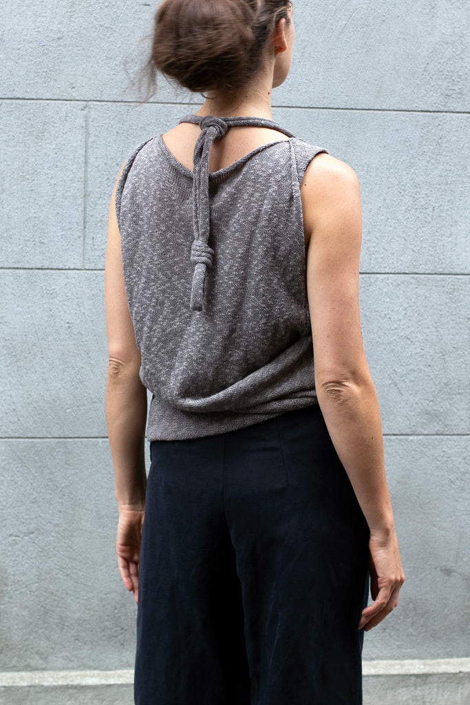 Back view of Double Up Top design by Wendy Voon knits in taupe linen cotton, loop worn knotted and around the neck