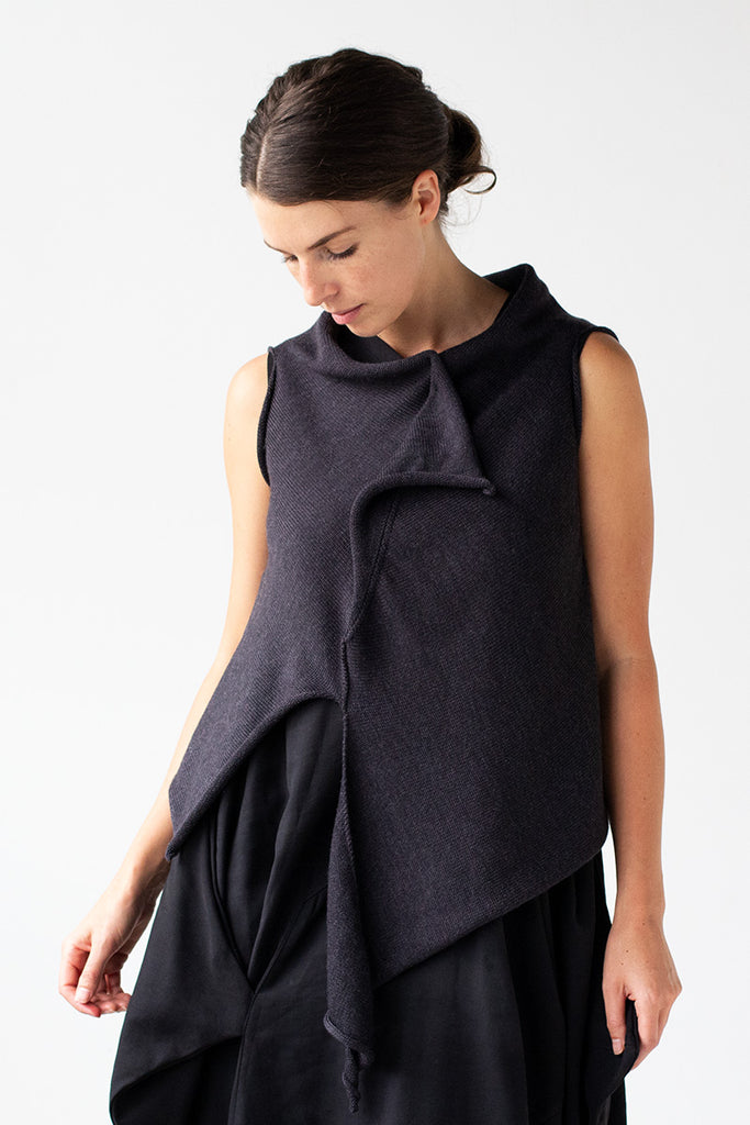 Front view of Asymmetric Self Curling Vest design by Wendy Voon knits in charcoal merino wool