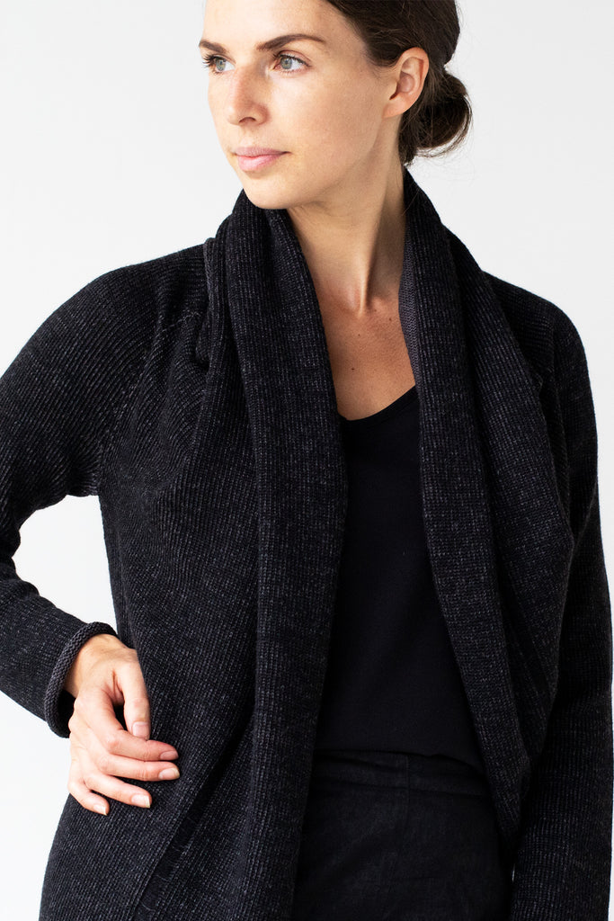 Front detail view of the Merino Cross Over design by Wendy Voon in charcoal and black fleck showing open front neckline