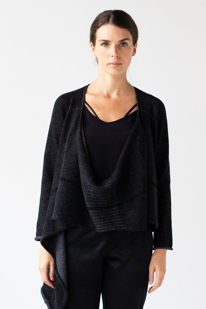 Front detail view of the Merino Cross Over design by Wendy Voon in charcoal and black fleck worn open with front drape