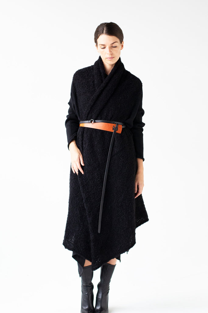Full length front view of Logical Progression Coat by Wendy Voon in black merino and alpaca wool, worn long and belted at waist