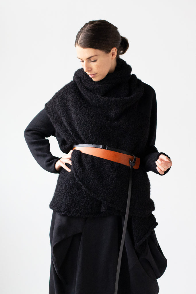 Front view of Logical Progression Coat in black merino and alpaca, worn short, belted at waist and collar worn scarf style