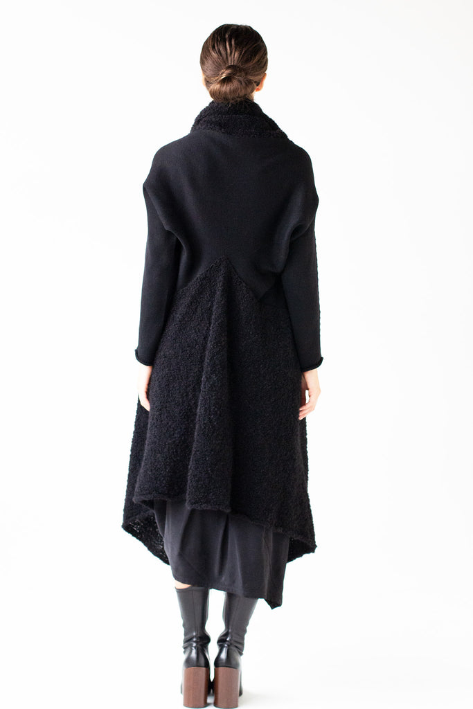Full length back view of Logical Progression Coat by Wendy Voon in black merino and alpaca, showing V shape waist detail