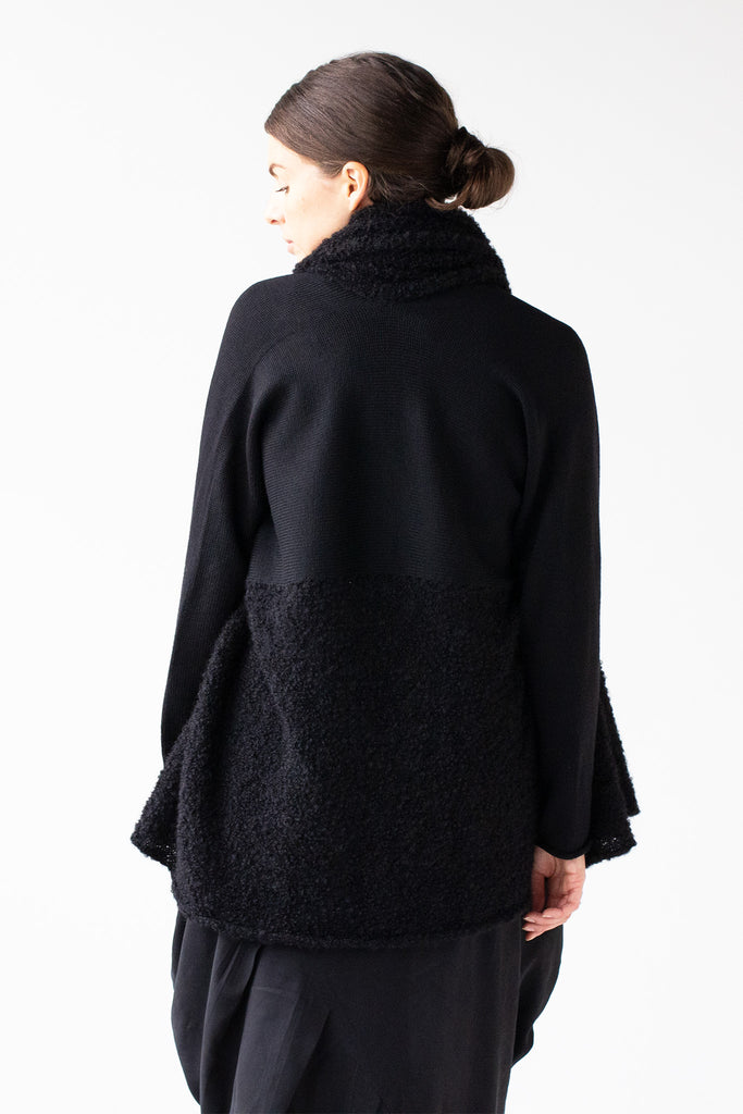 Back view of Logical Progression Coat by Wendy Voon in black merino and alpaca, worn short with straight waist seam