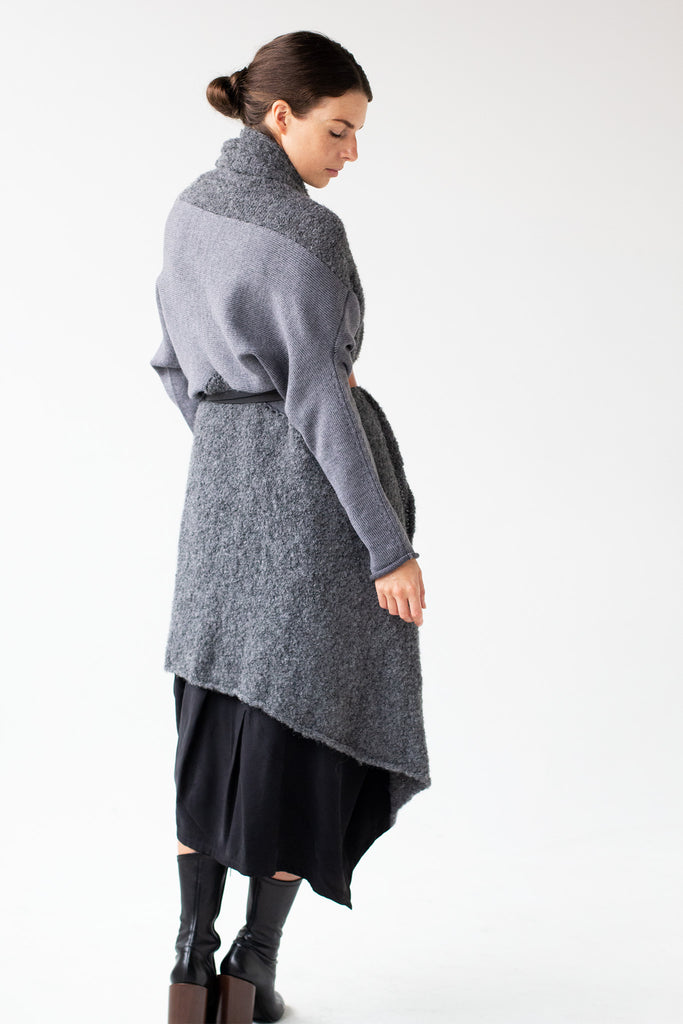 Side back view of Logical Progression Coat by Wendy Voon in storm grey merino and alpaca, worn long and belted at waist