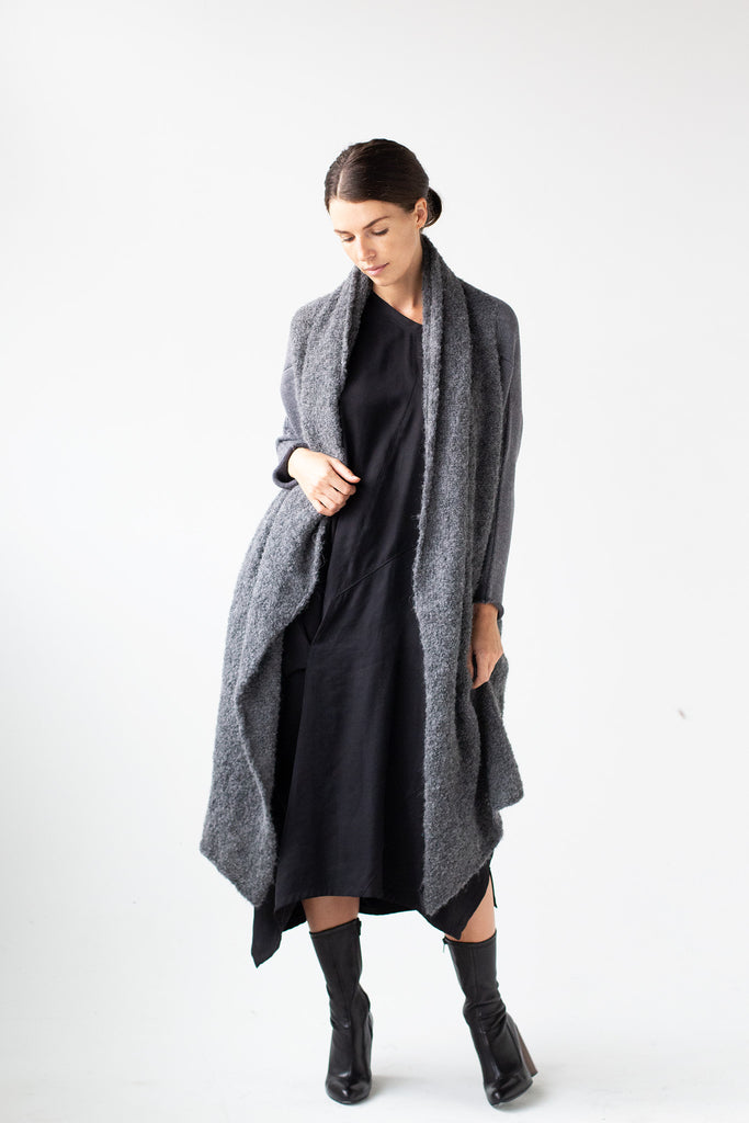 Full length front view of Logical Progression Coat by Wendy Voon in storm grey merino and alpaca, worn long and open fronted