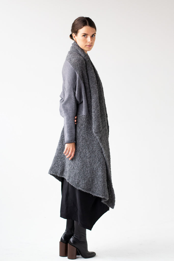 Side front view of Logical Progression Coat by Wendy Voon in storm grey merino and alpaca, worn long and open