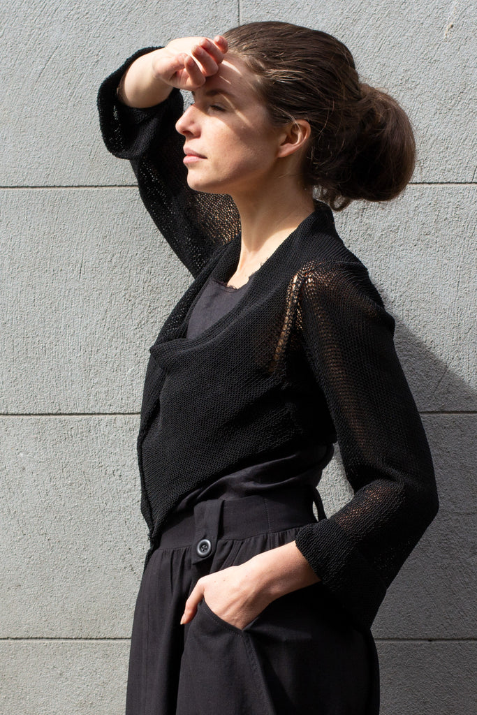 Side front view of Cropped Viscose Jumper design by Wendy Voon knits in black, showing cropped hem length
