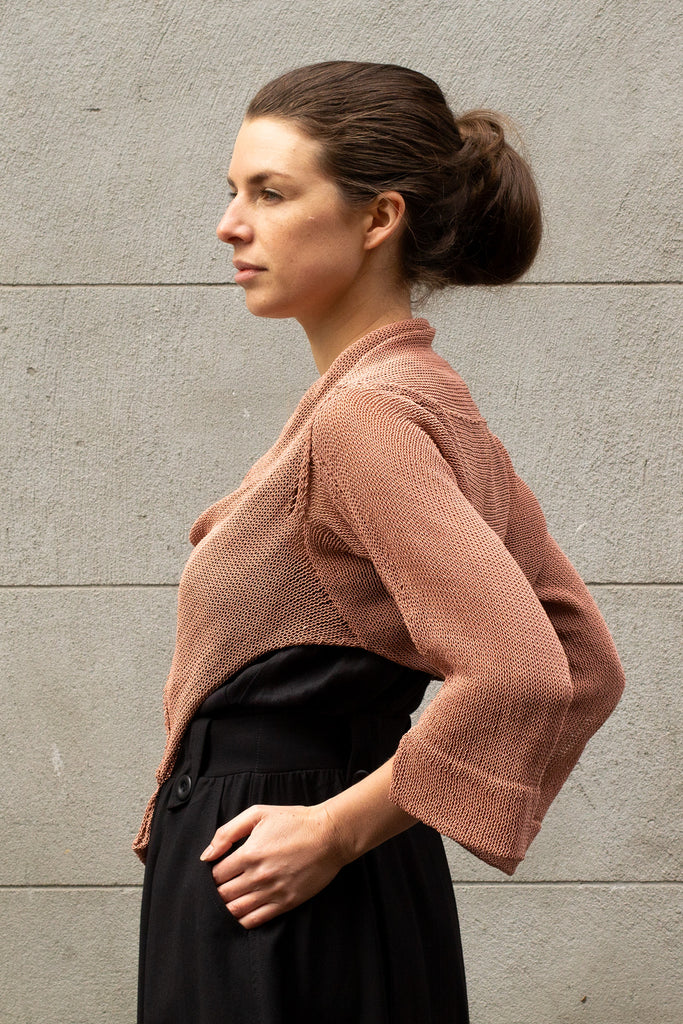 Side view of Cropped Viscose Jumper design by Wendy Voon knits in dusty pink, showing cropped hem length