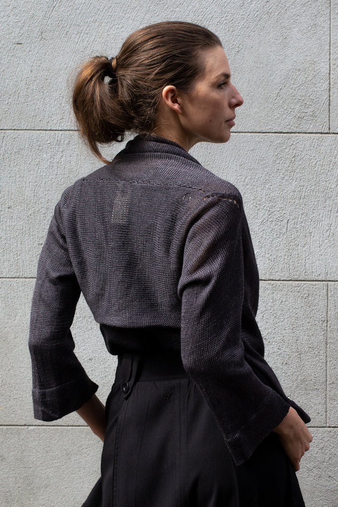 Back view of Cropped Jumper in Linen design by Wendy Voon knits in charred eggplant colour, showing back yoke seam detail
