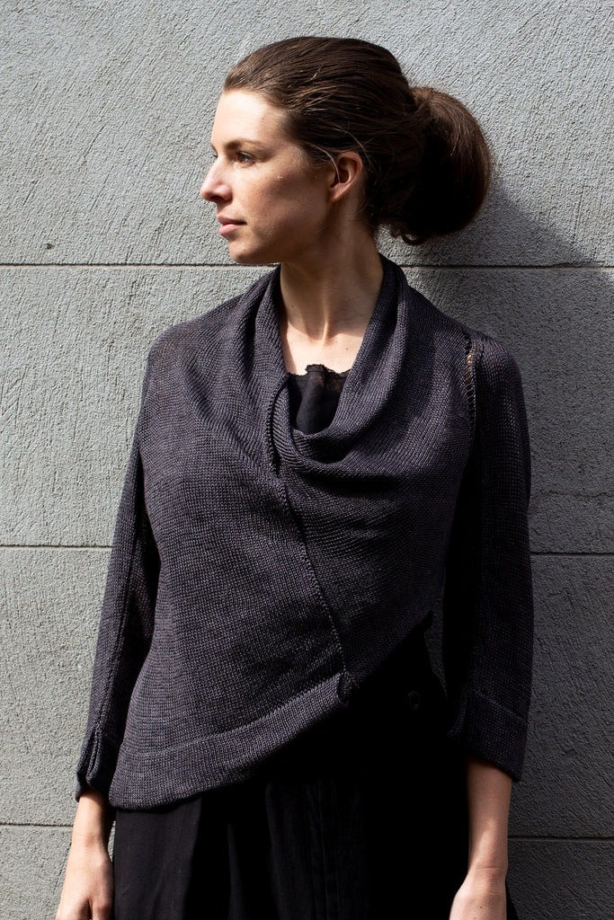 Front view of Cropped Jumper in Linen design in charred eggplant colour linen, showing front seam and sleeve lace detail