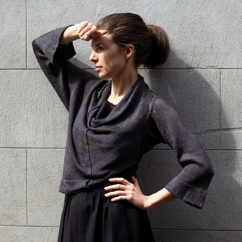 Front view of Cropped Jumper in Linen design by Wendy Voon knits in charred eggplant colour linen, showing cowl neck style