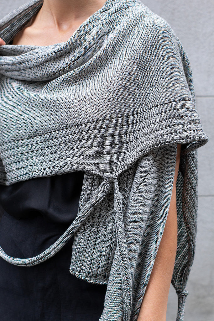 Front detail view of Multi-Wrap in Linen by Wendy Voon in silver linen with black reverse, worn as cropped shawl style wrap