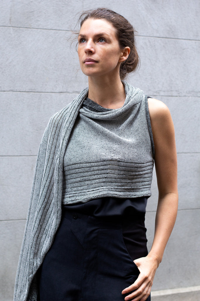 Front view of Multi-Wrap in Linen by Wendy Voon in silver linen with black reverse, worn as cropped shawl style wrap