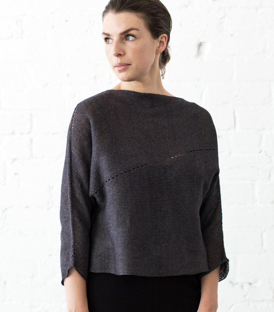 Front view of Linen Batwing jumper design by Wendy Voon knits in charred eggplant linen, showing lace eyelet detail