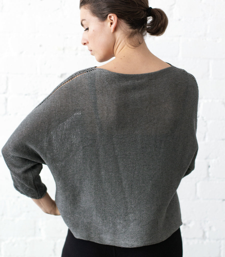Back view of Linen Batwing jumper design by Wendy Voon knits in pewter linen, showing batwing silhouette