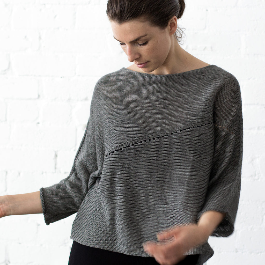 Front view of Linen Batwing jumper design by Wendy Voon knits in pewter linen, showing lace eyelet detail