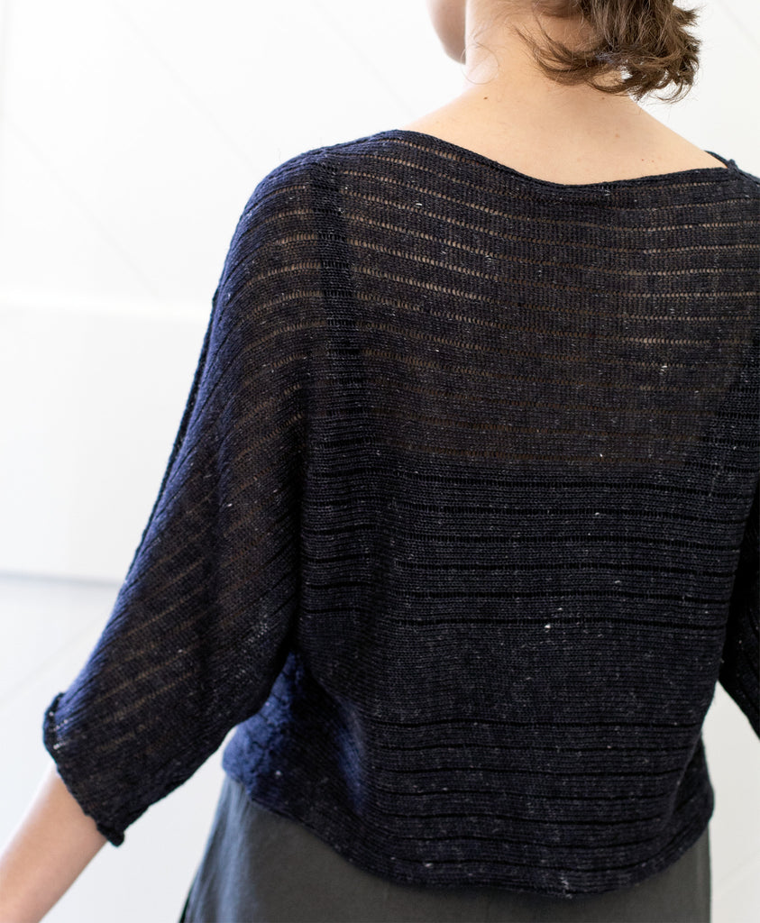 Back view of Linen Laddered Batwing jumper design by Wendy Voon in charcoal flecked linen and merino, shows batwing silhouette