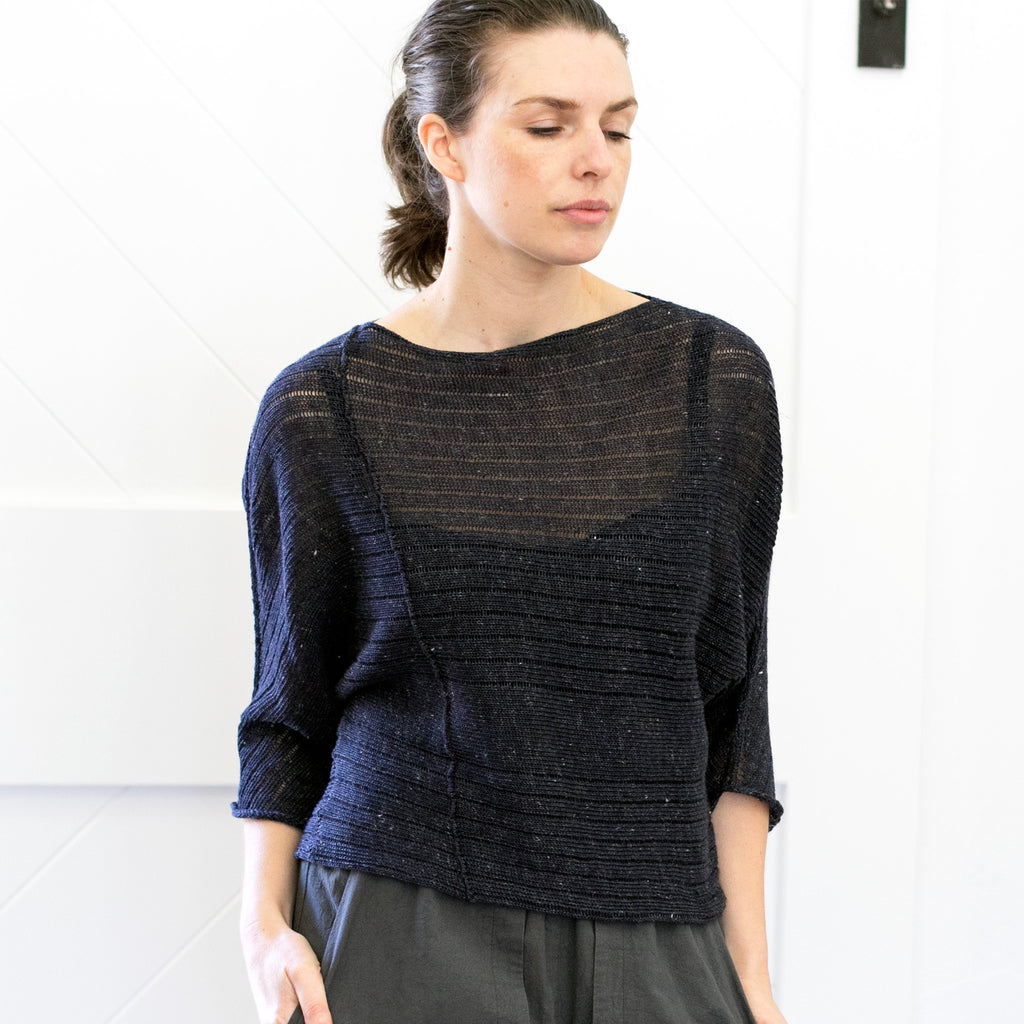 Front view of Linen Laddered Batwing jumper design by Wendy Voon in charcoal flecked linen and merino, showing seam detail