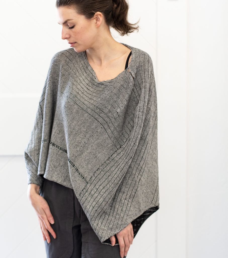 Front view of Linen Poncho design by Wendy Voon knits in silver grey linen cotton backed with black merino wool