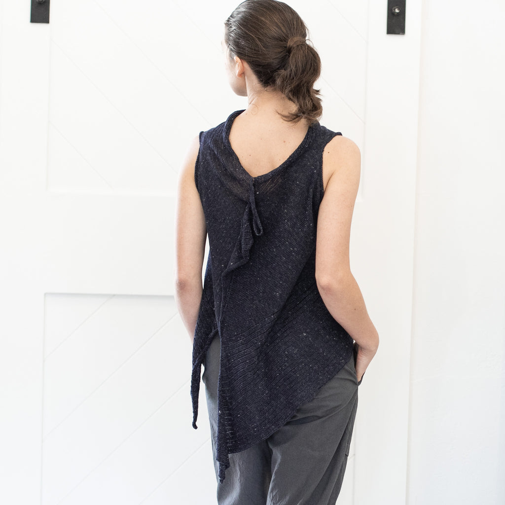 Back view of Linen Laddered Vest design by Wendy Voon knits in charcoal flecked linen, worn back to front