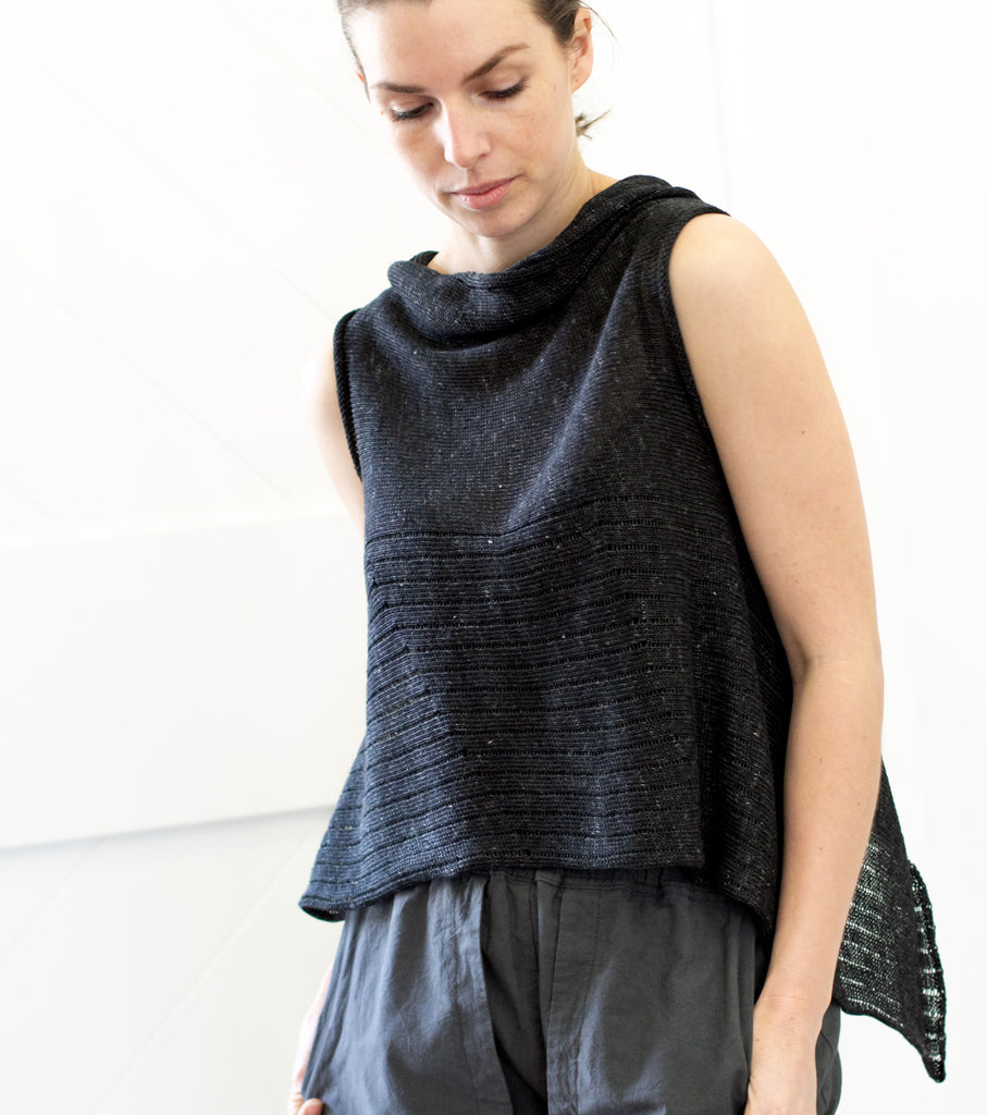 Front view of Linen Laddered Vest design by Wendy Voon in charcoal flecked linen, worn back to front in a cropped vest style