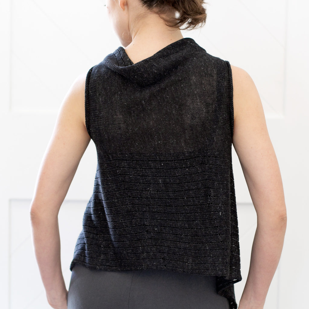 Back view of Linen Laddered Vest design by Wendy Voon knits in charcoal flecked linen, showing laddered fabric design detail