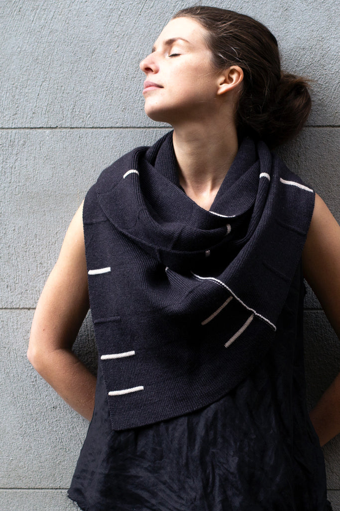 Front view of Linework Scarf design by Wendy Voon in charcoal merino with cream stripes, worn double looped infinity style