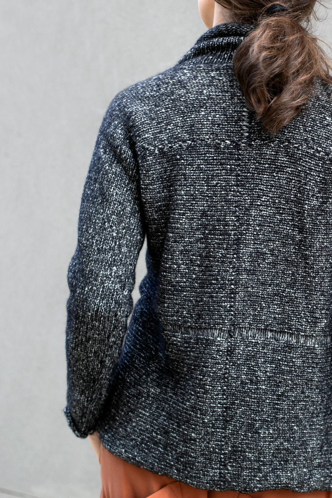Back view of the Wendy Voon knits 'Live with Ease' jumper design in graphite marle wool