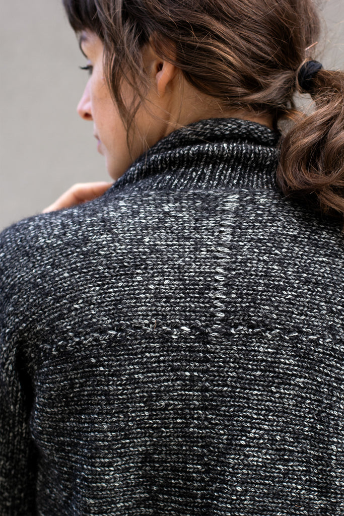 Detail of back view of the Wendy Voon knits 'Live with Ease' jumper design in graphite marle wool