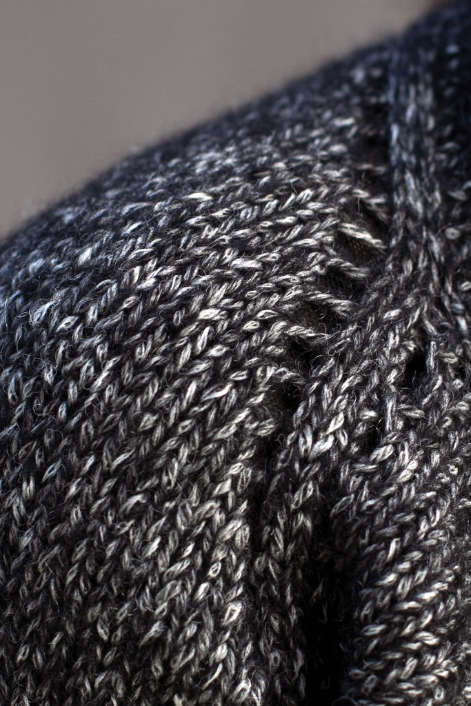 Close up view of stitch detail of the Wendy Voon knits 'Live with Ease' jumper design in graphite marle wool