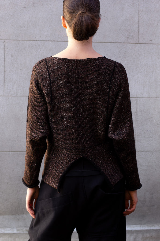 Back of metallic dolmain jumper with brown gold side showing