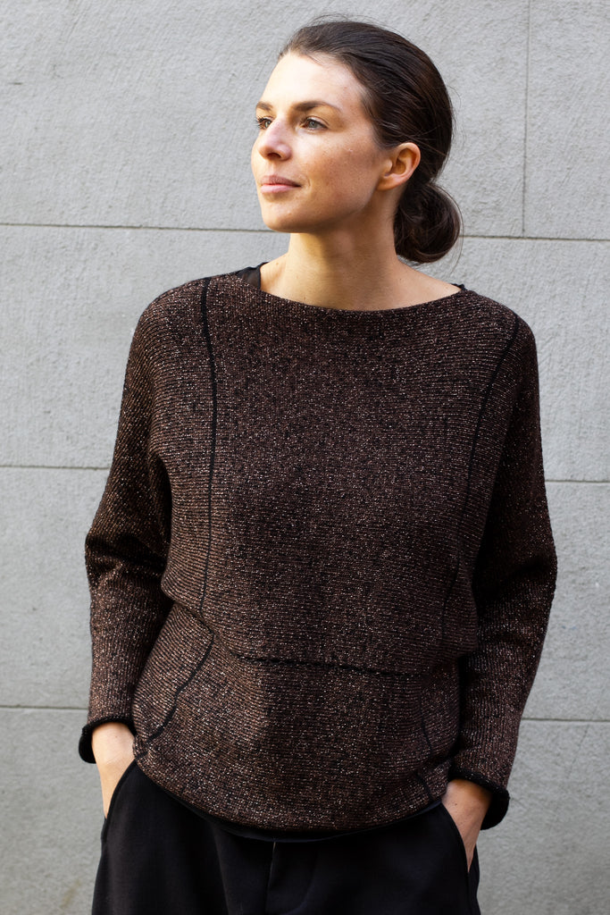 Front of metallic dolmain jumper with brown gold side showing