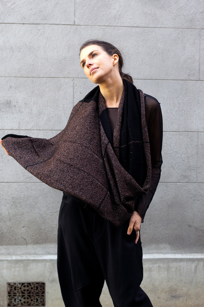 Two toned metallic scarf in black and brown gold, draped as a wrap over the shoulders