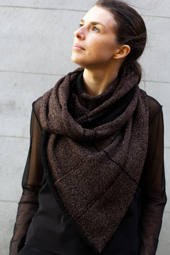 Two toned metallic scarf in black and brown gold, looped twice around the neck