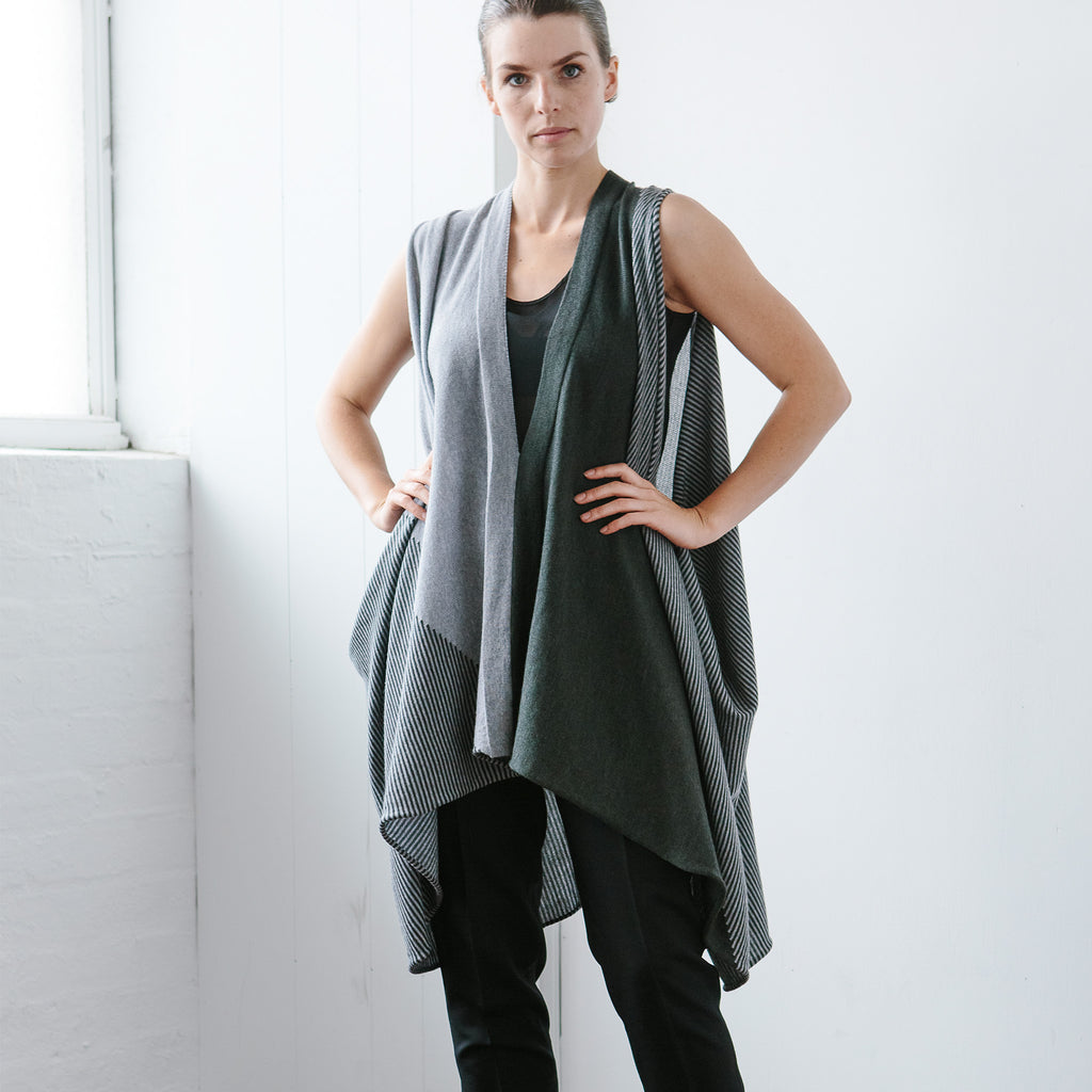 Front view of Striped Wrap design by Wendy Voon knits in grey and deep forest merino wool, worn as v neck, long loose vest