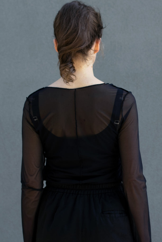 Back view of black sheer mesh round neck long sleeved top designed by Wendy Voon, featuring centre back seam detail.