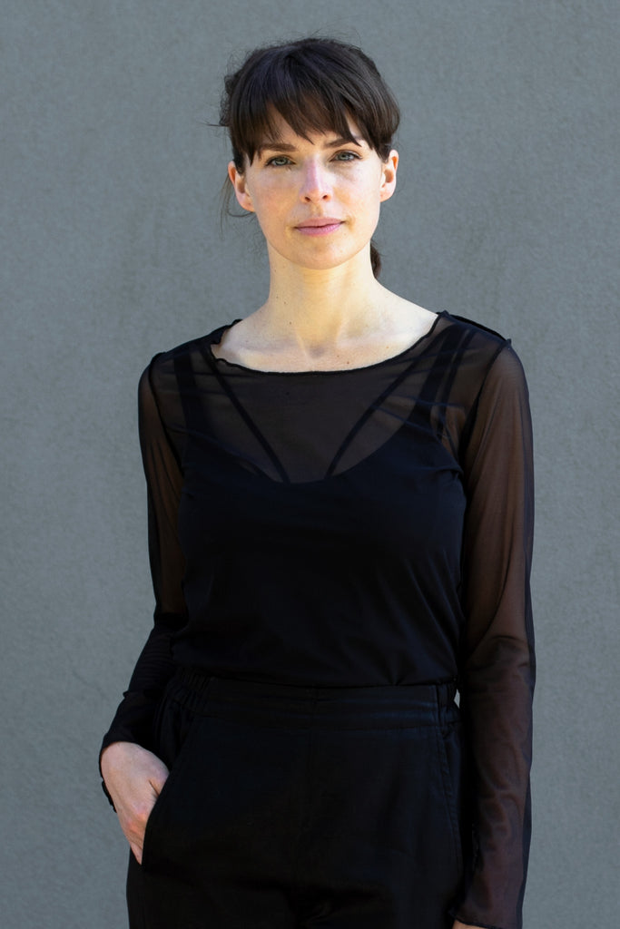Front view of black sheer mesh round neck long sleeved top designed by Wendy Voon.