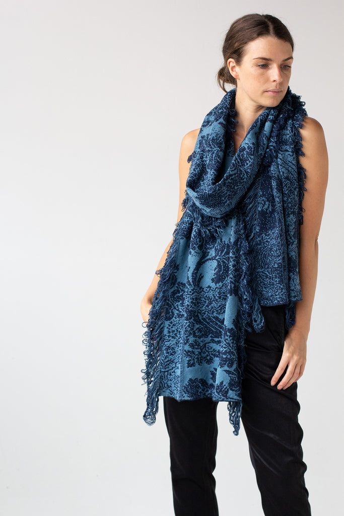 Front silhouette view of deep ocean and lagoon colour Damask Scarf by Wendy Voon knitted in merino wool, linen and cotton