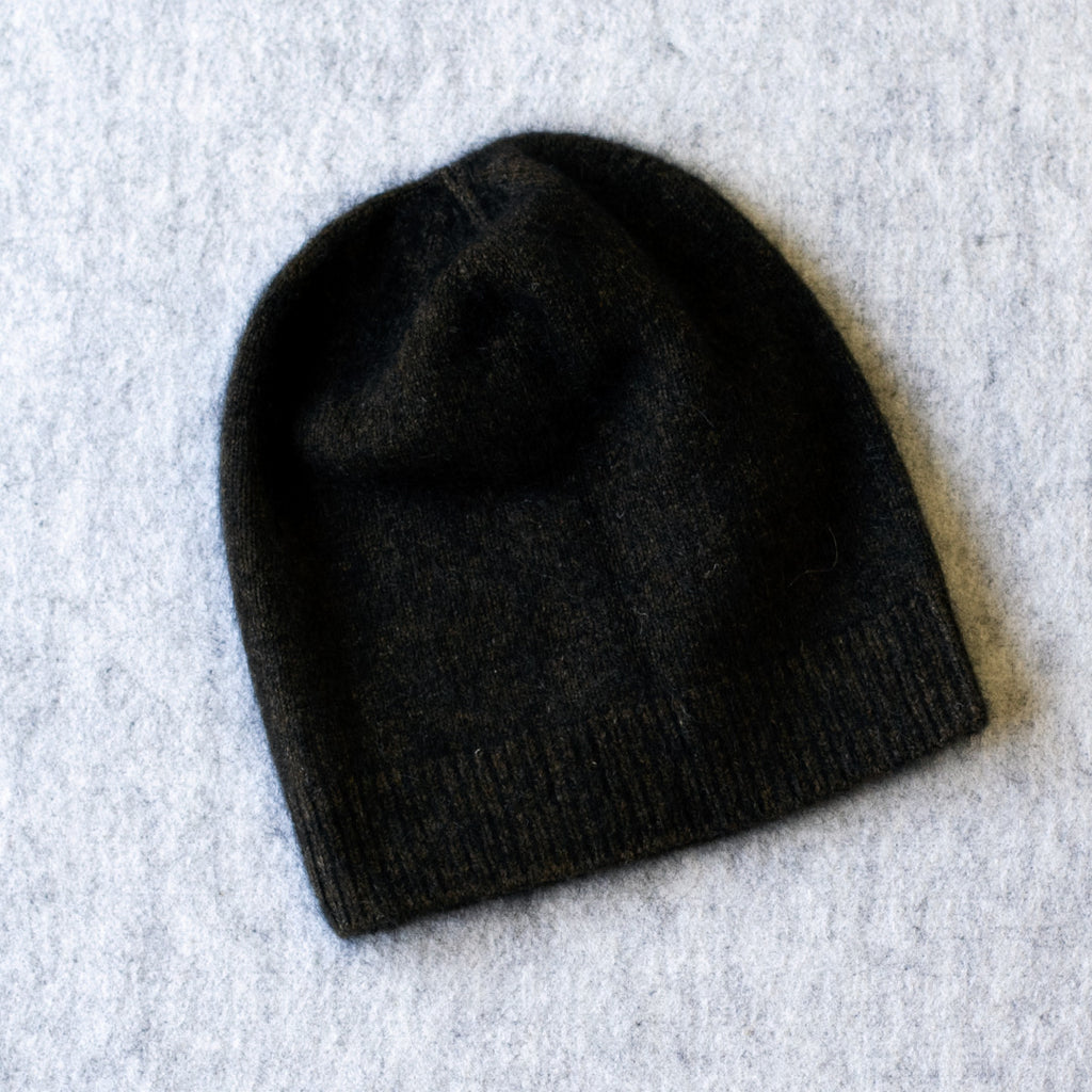 Dark brown coloured knitted beanie made from merino wool, possum and silk