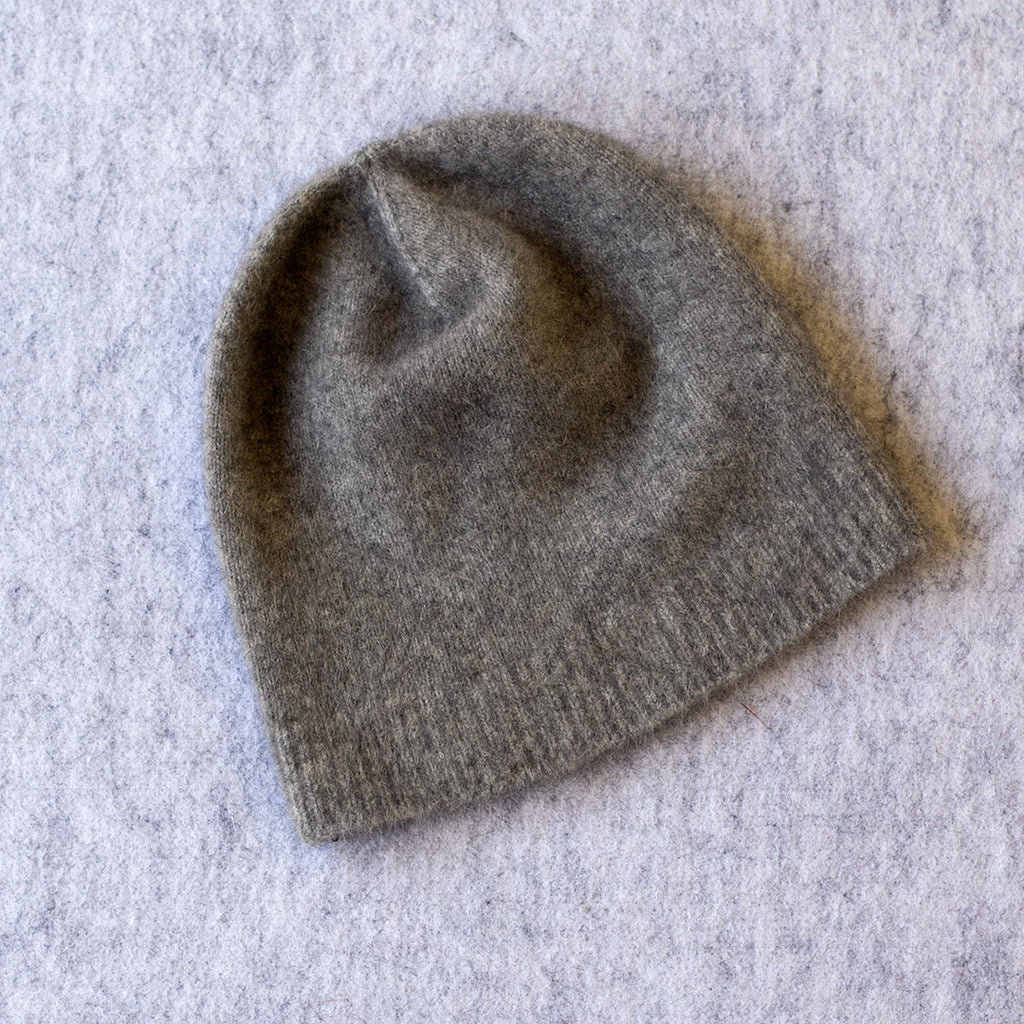 Light grey coloured knitted beanie made from merino wool, possum and silk