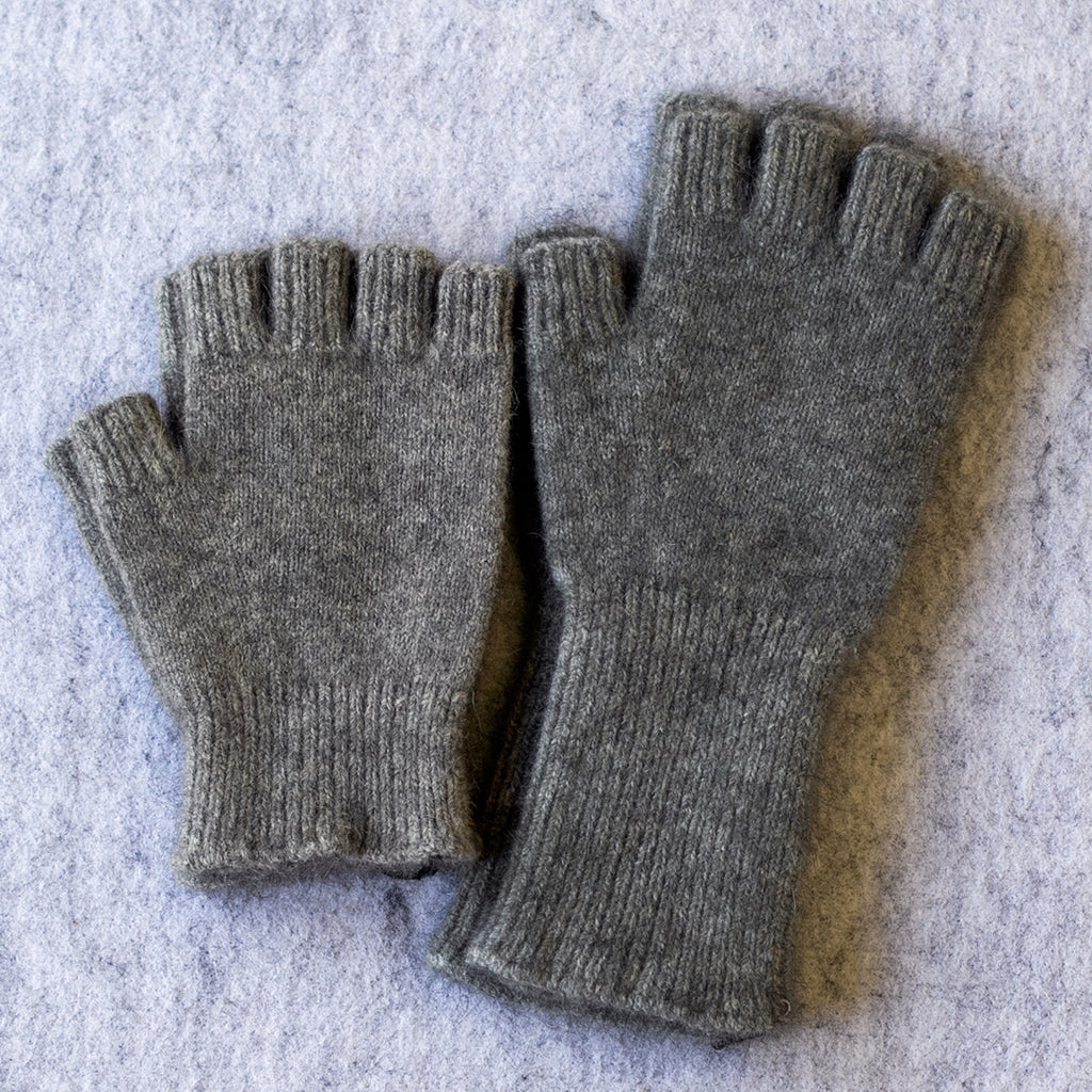 Light Grey coloured fingerless gloves in a merino wool, possum and silk blend
