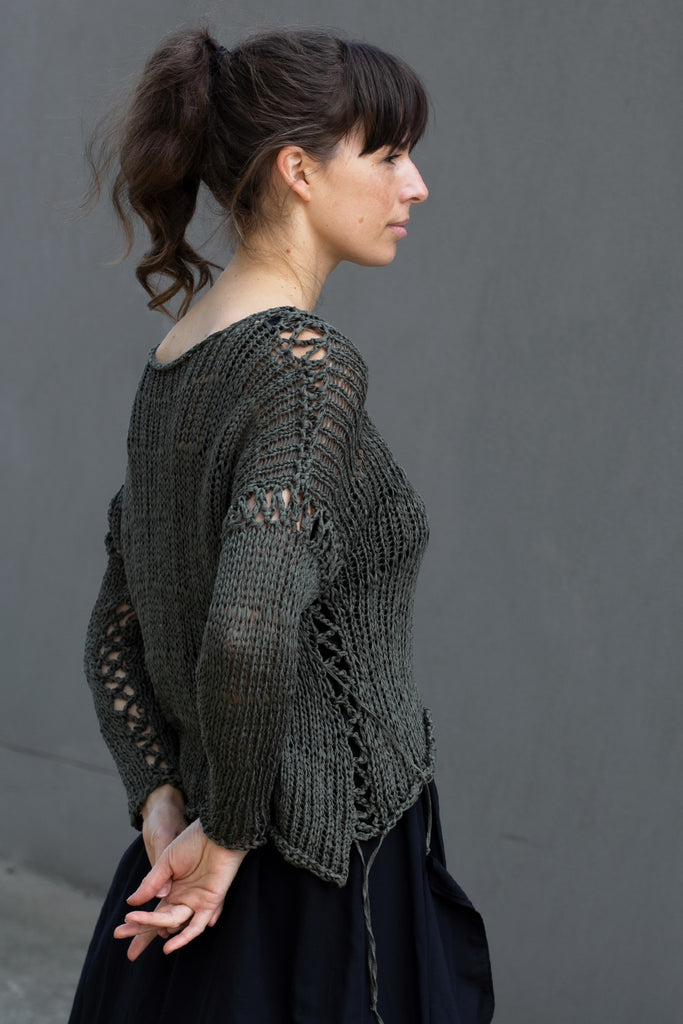 Side view of extra large stitch jumper in khaki, designed by Wendy Voon