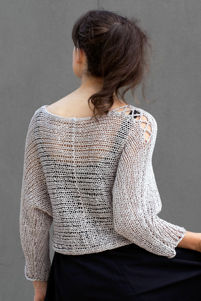 CBack view  of Large Stitch Batwing jumper, knitted  in Pearl cotton and designed by Wendy Voon