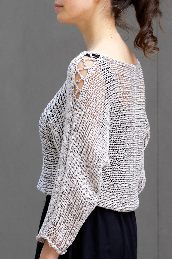 Side view showing sleeve detail  of Large Stitch Batwing jumper, knitted  in Pearl cotton and designed by Wendy Voon