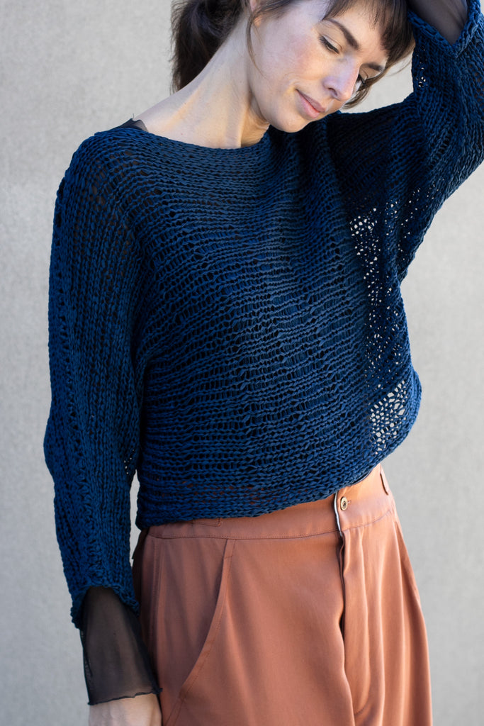Close up view  of Large Stitch Batwing jumper, knitted  in Ocean coloured cotton ribbon yarn, designed by Wendy Voon