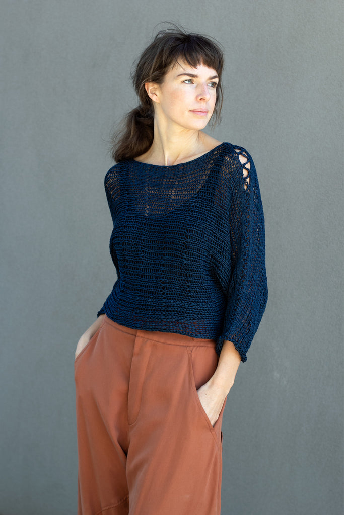 Front view  of Large Stitch Batwing jumper, knitted  in Ocean coloured cotton ribbon yarn, designed by Wendy Voon